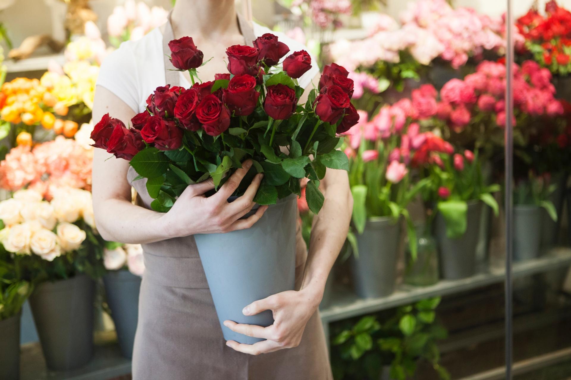 お花を持つお花屋さん